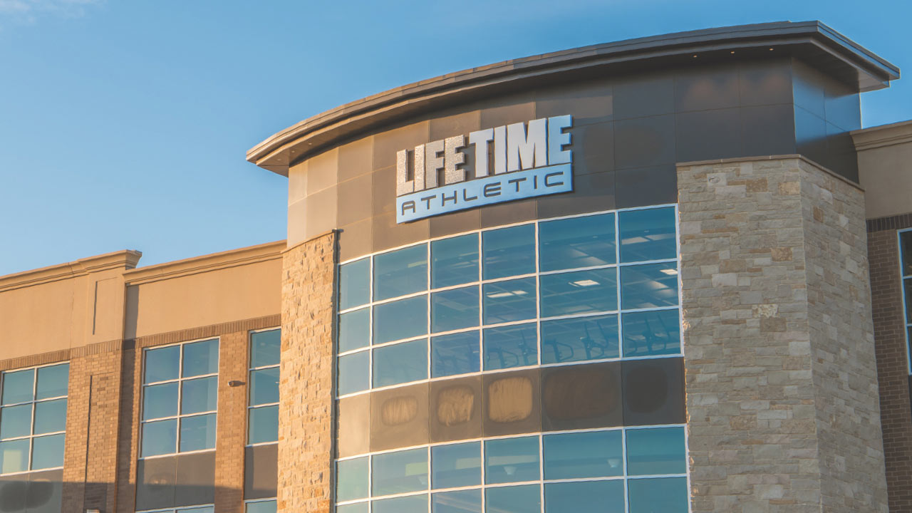 The close up of the Life Time sign on a Life Time building