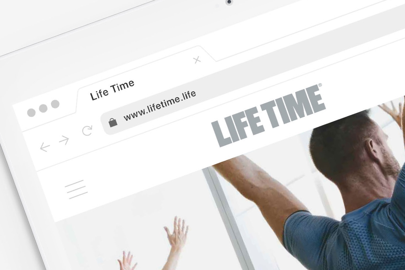 An iPad showing the Life Time website