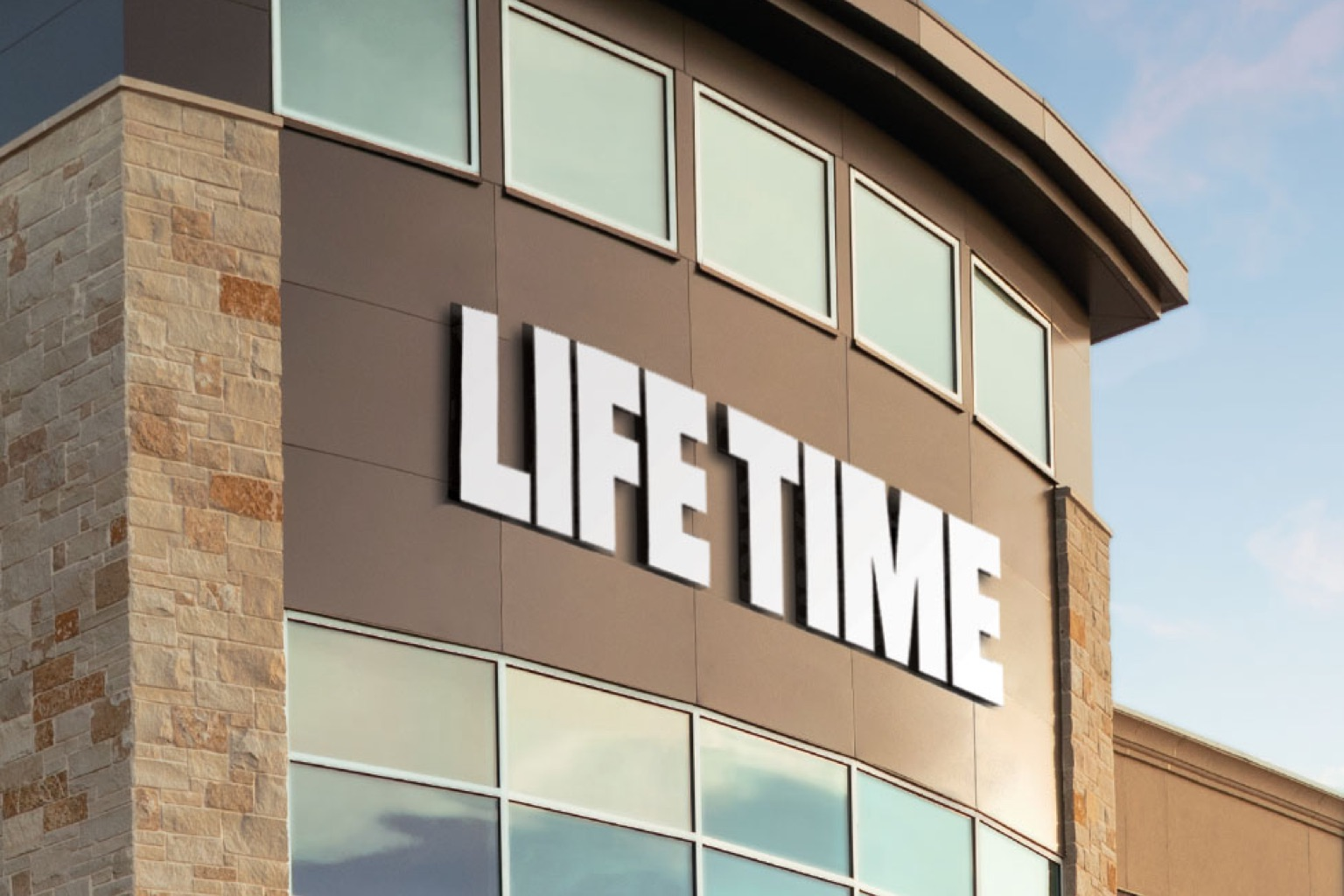 A close up view of the Life Time logo on the front of a Life Time building.