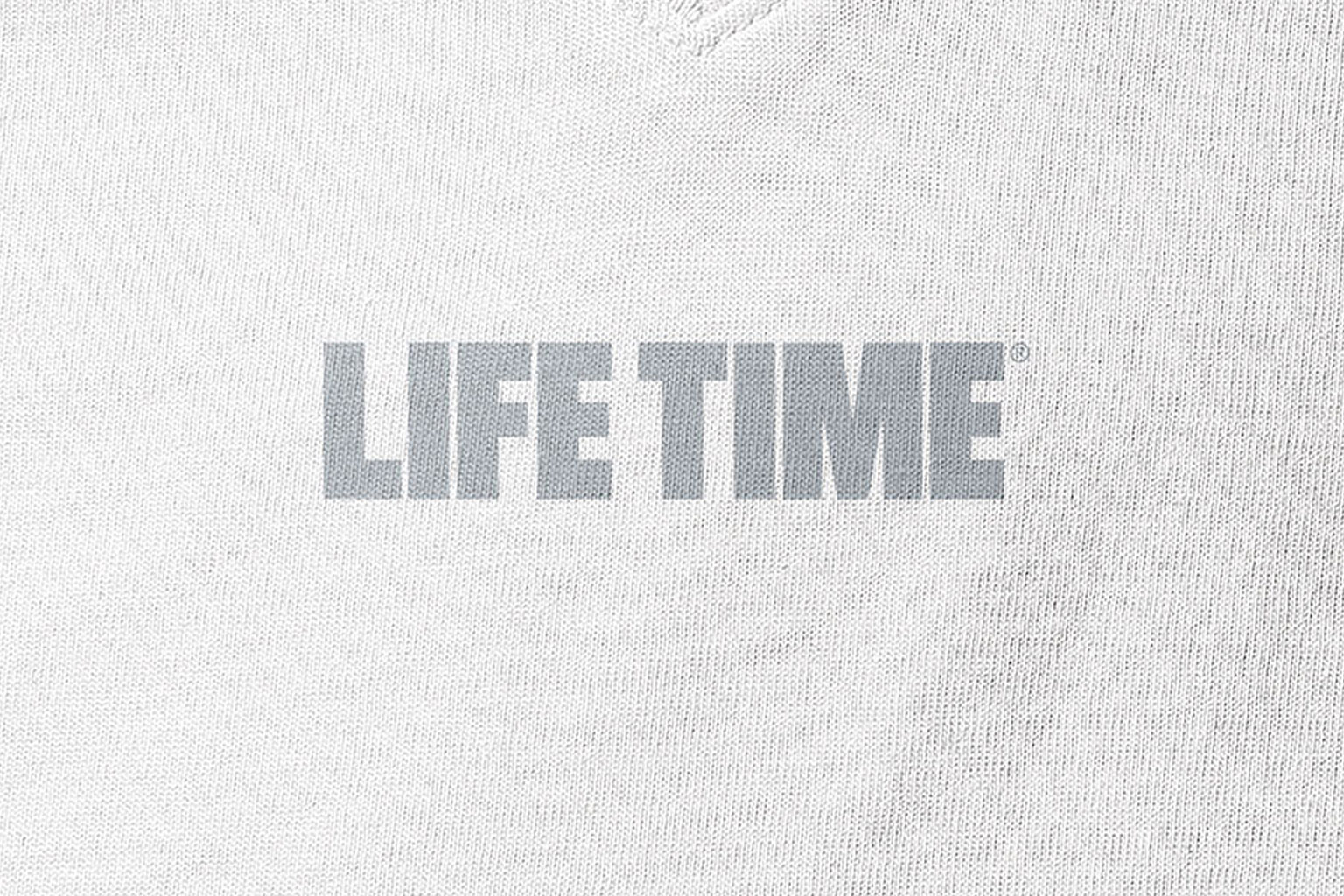 Silver Life Time master logo on a white fabric background
