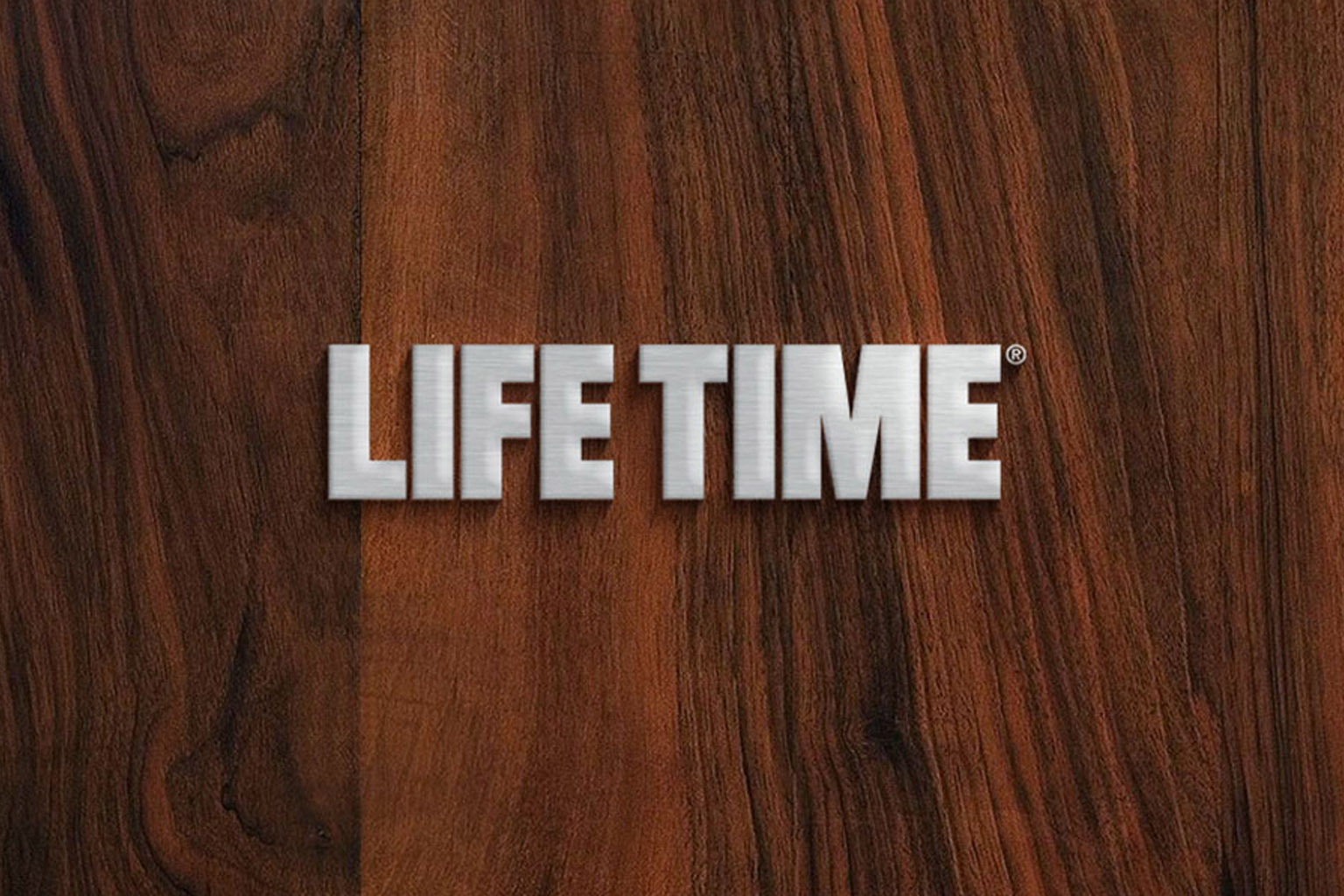 Silver Life Time master logo on a wood background