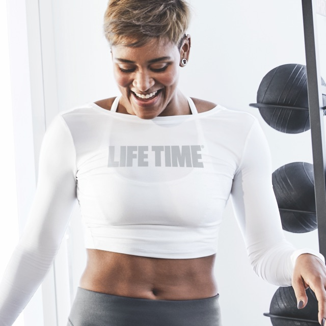 Woman working out with a personal trainer at Life Time