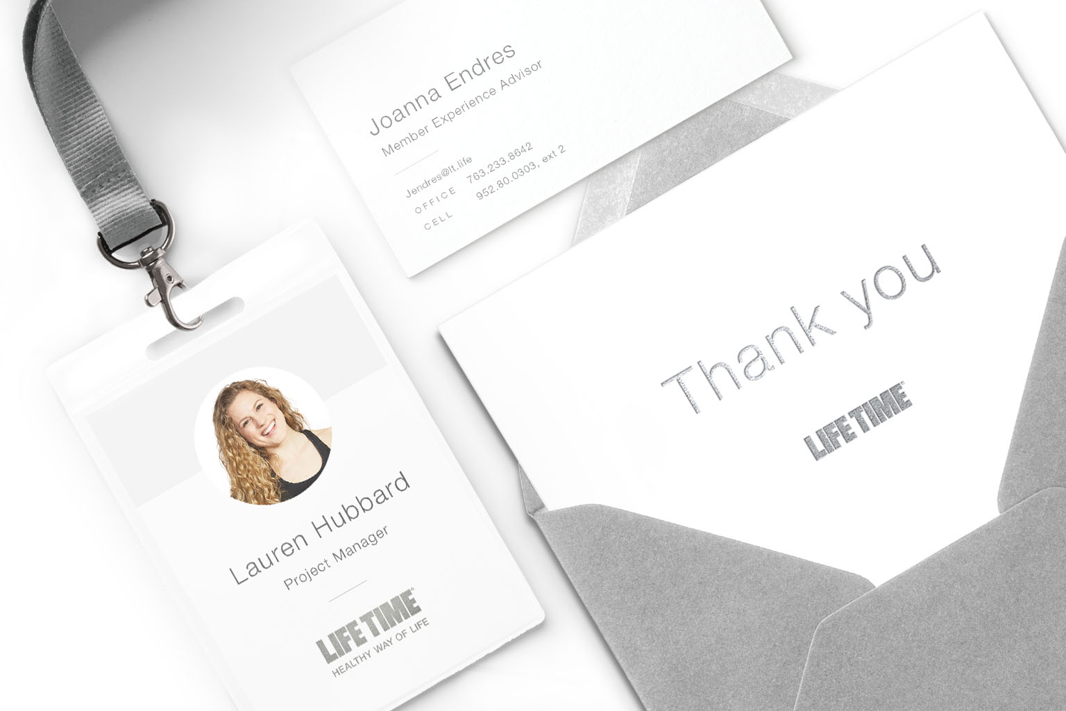 Examples of Life Time business cards, employee badge and stationery