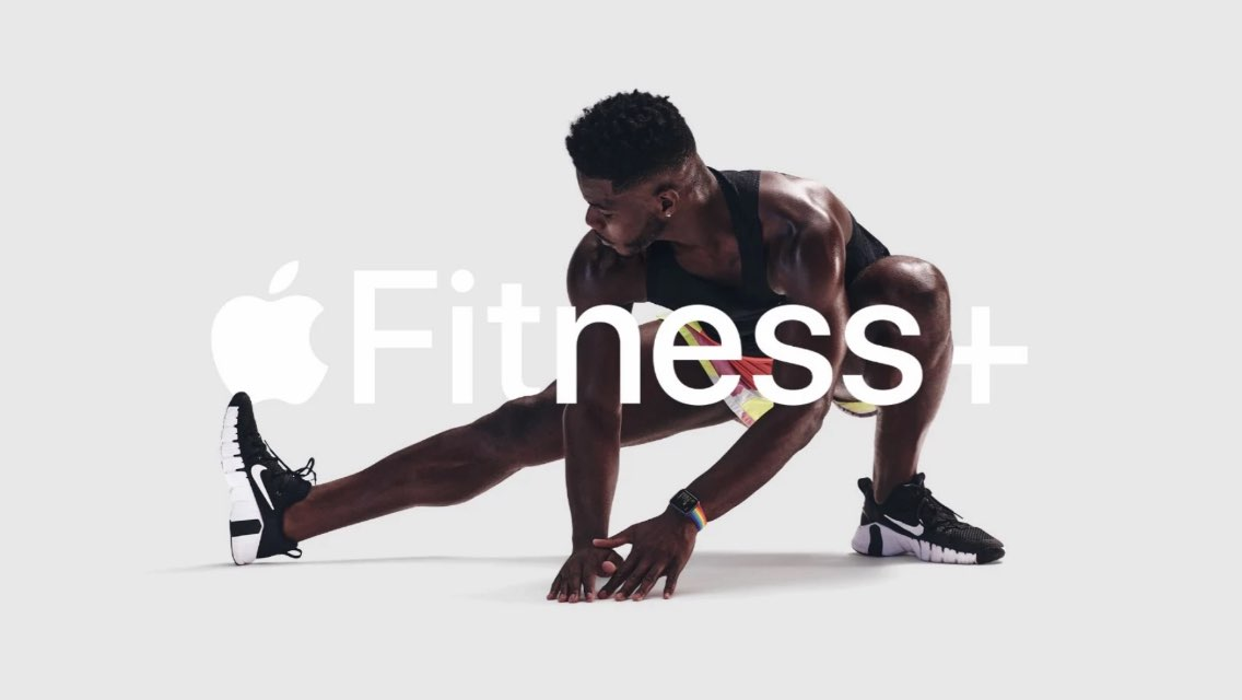Man doing a side lunge and an Apple Fitness+ logo over him.