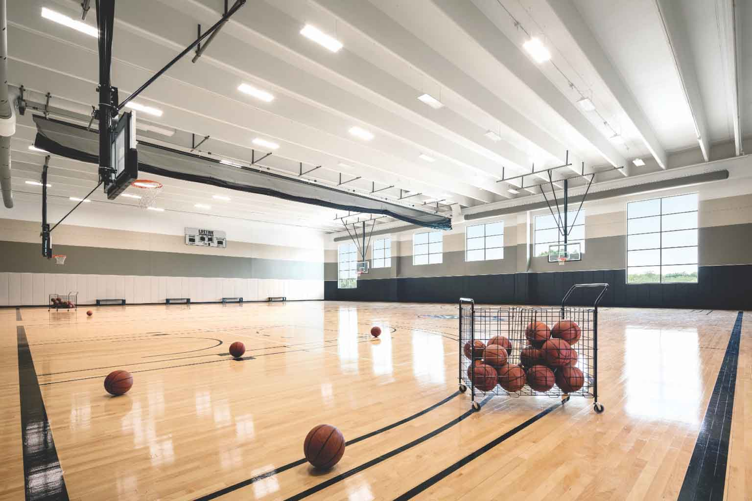 Life tim'es gymnasium equipped with basketballs and hoops
