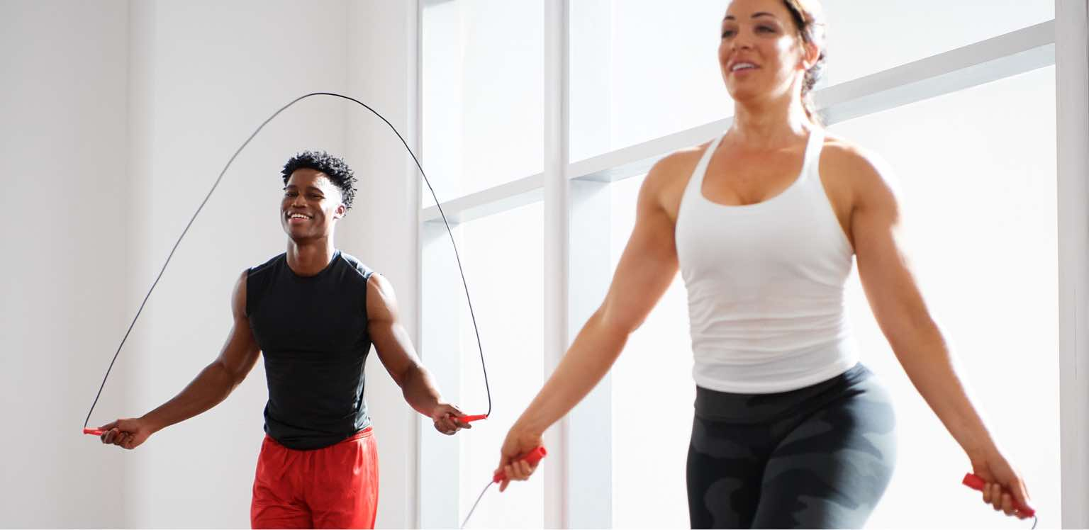 Two people jumping rope at Life Time