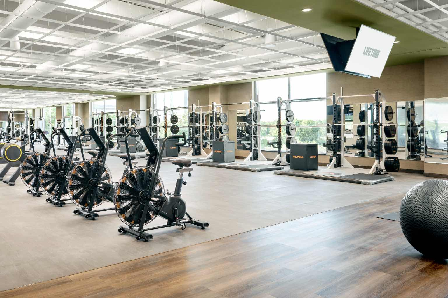 Fitness floor with weight racks and interior bikes