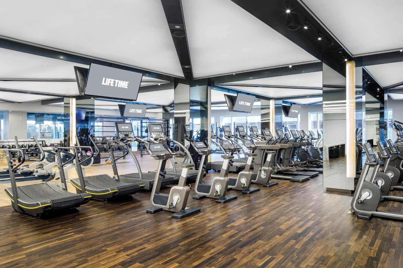 Rows of cardio equipment and televisions at life time