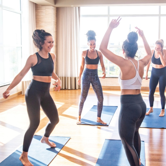 Women celebrating inside of a group fitness class
