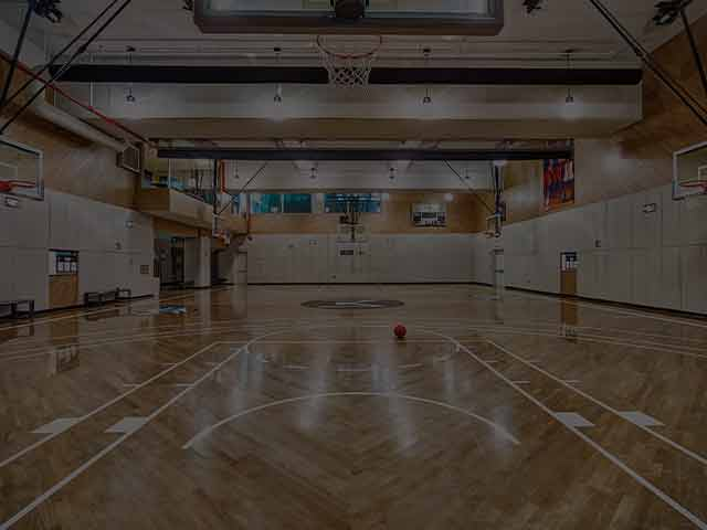An image of a basketball court at a Life Time facility