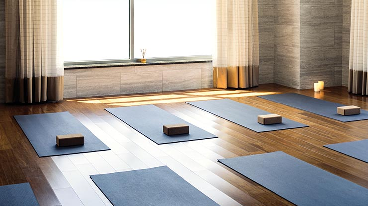 The interior of a yoga studio at Life Time