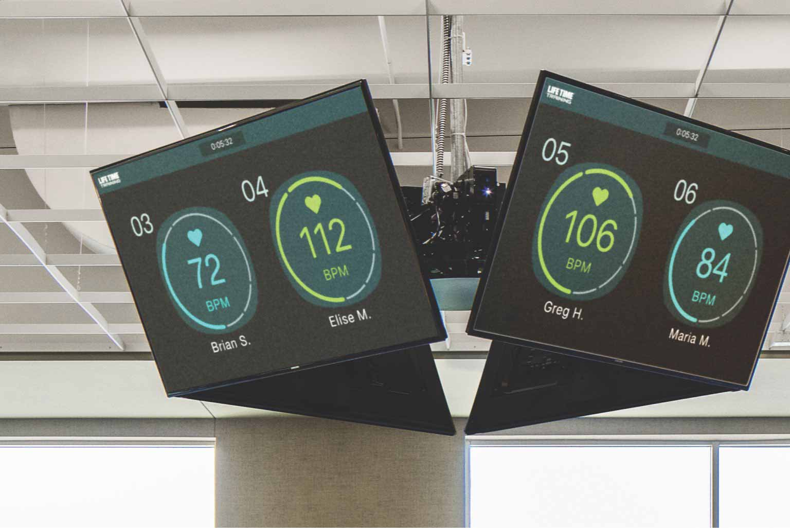 two TV screens showing heart rate monitors