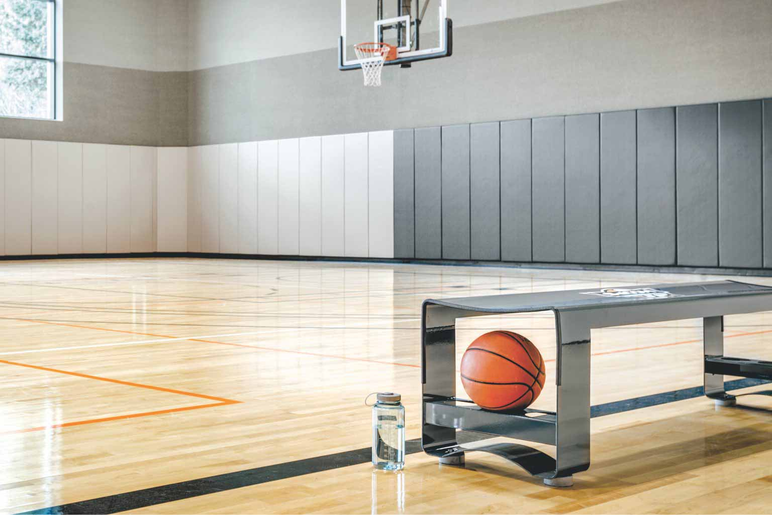 Bench and Basketball on the floor of gym