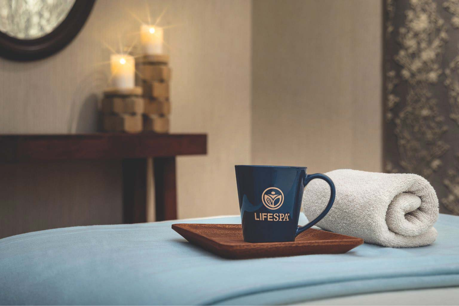 Life Time coffee cup on a massage table with a white towel