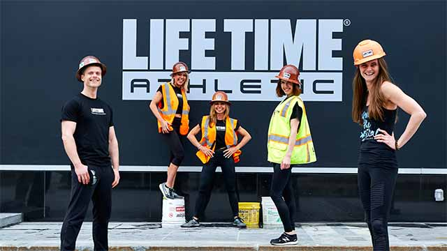 Chestnut Hill Life Time Athletic instructors posing with construction uniforms