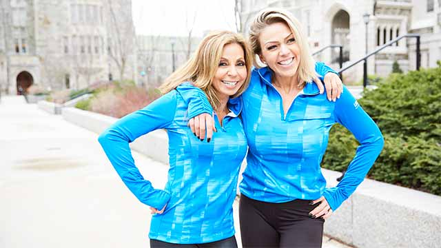 2 smiling female instructors posing in matching blue shirts