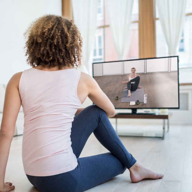 Woman watching at home work outs