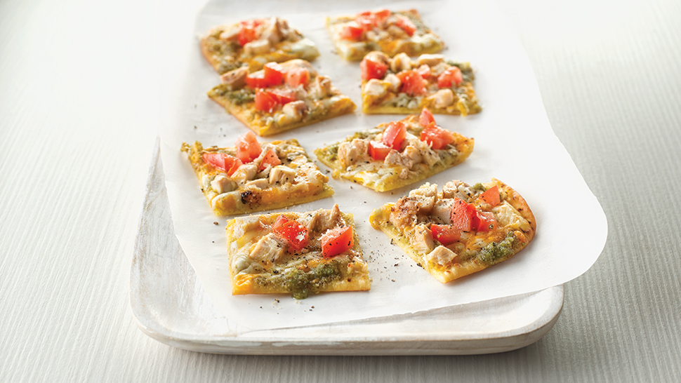 A chicken and tomato flatbread pizza