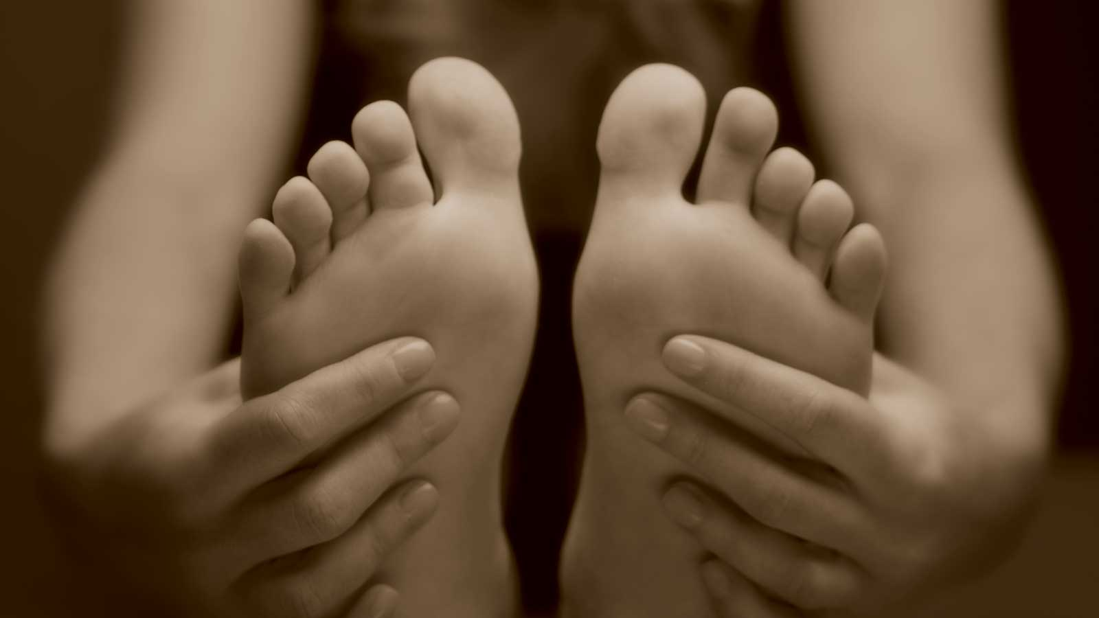 A woman's feet and hands, with manicure and pedicure