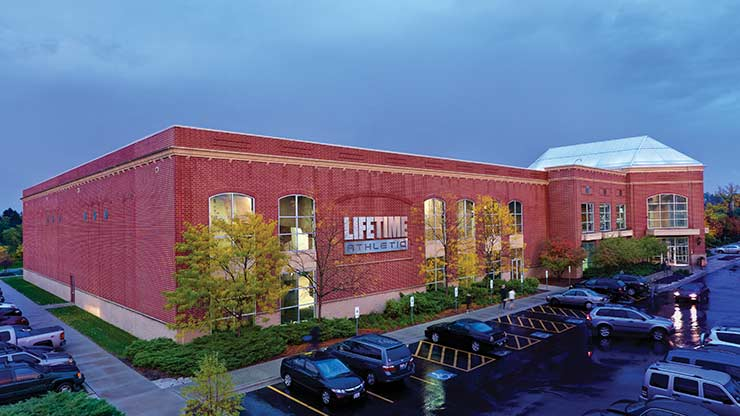 The brick exterior of Life Time Athletic Old Orchard, the premier health club in Skokie, IL