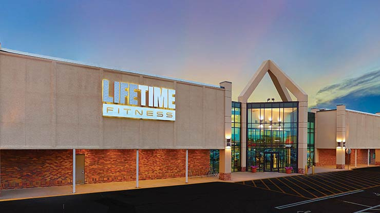 The glass entrance of Life Time Fitness, the best gym in Coon Rapids, MN
