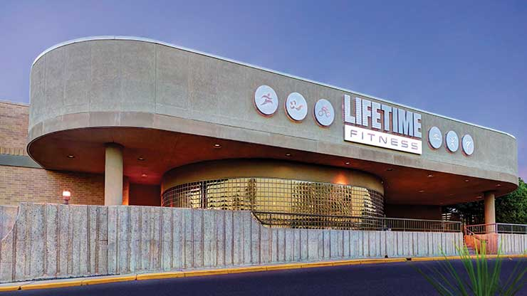 The glass extrance to Life Time Fitness, the best fitness center in Fridley, MN