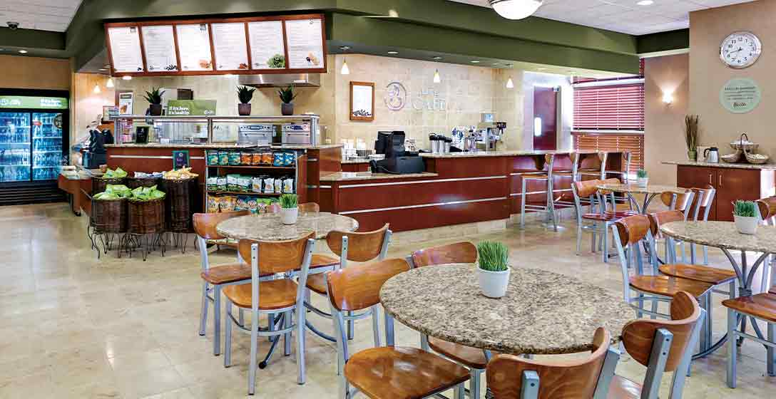 Tables, counter, and menus inside the Life Cafe at Life Time