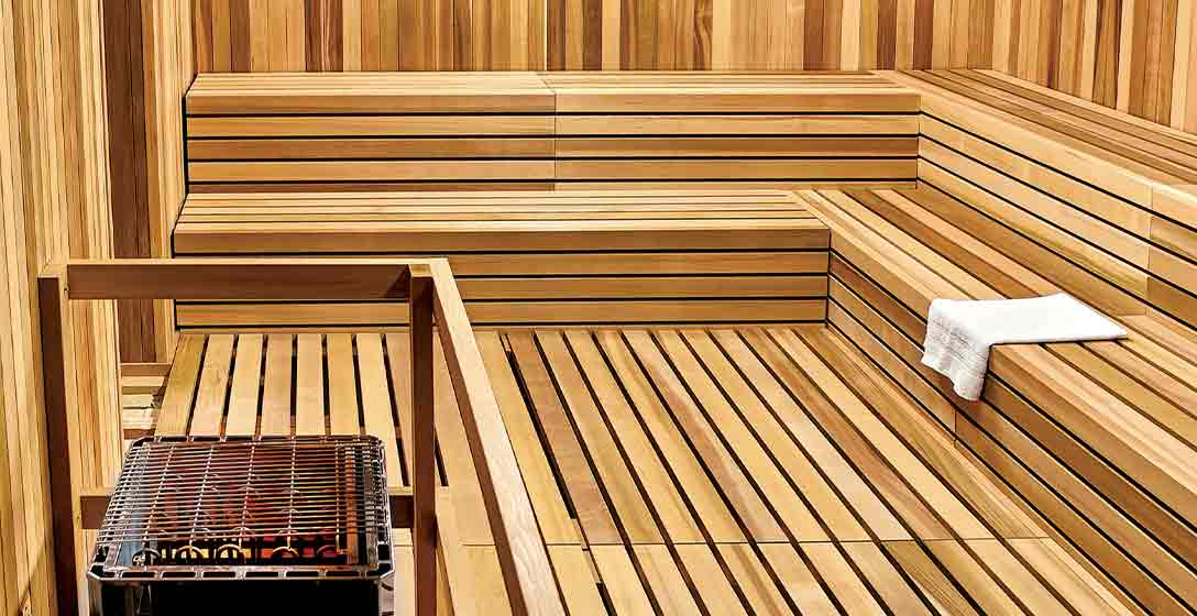 A towel laid out on the wood decking of a Life Time Sauna room