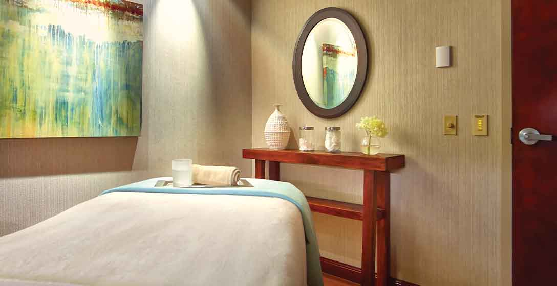 A massage table in a massage room at the Life Time Life Spa