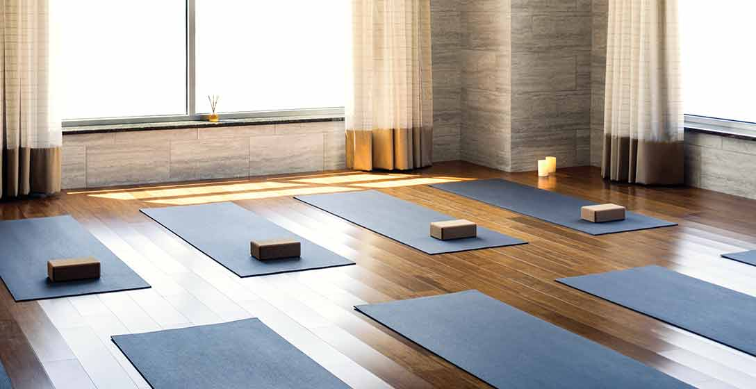 Yoga mats and blocks laid out in rows at a Life Time Yoga Studio