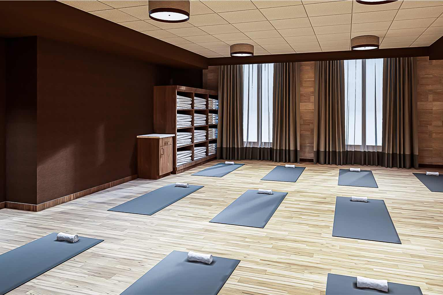 The yoga studio at Life Time 23rd Street is a place to build strength, flexibility and mindfulness.