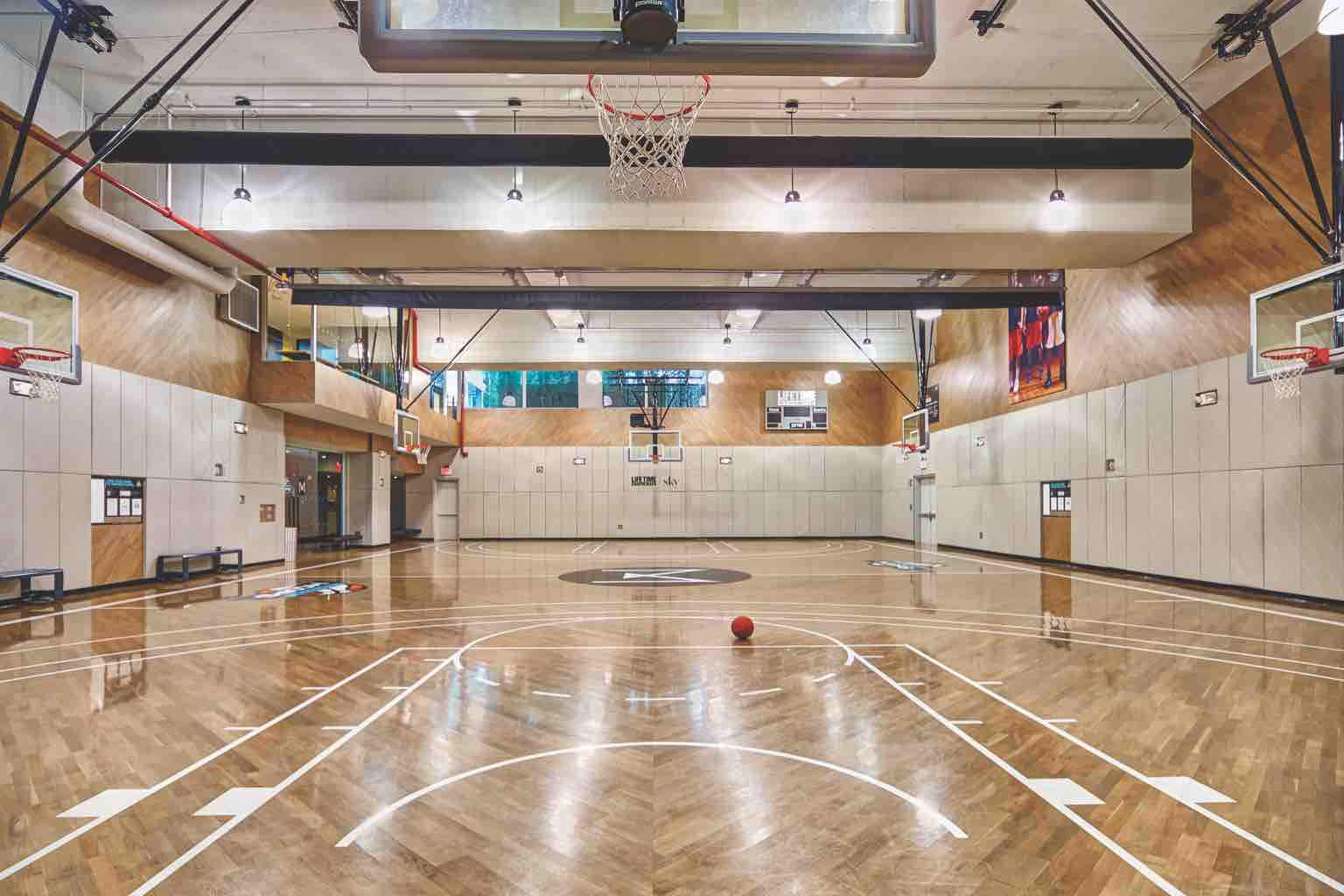 A photo of the expansive basketball court at Life Time Manhattan Sky.