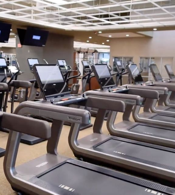 Row of treadmills at Life Time Northbrook