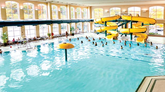 An indoor swimming pool and water slides