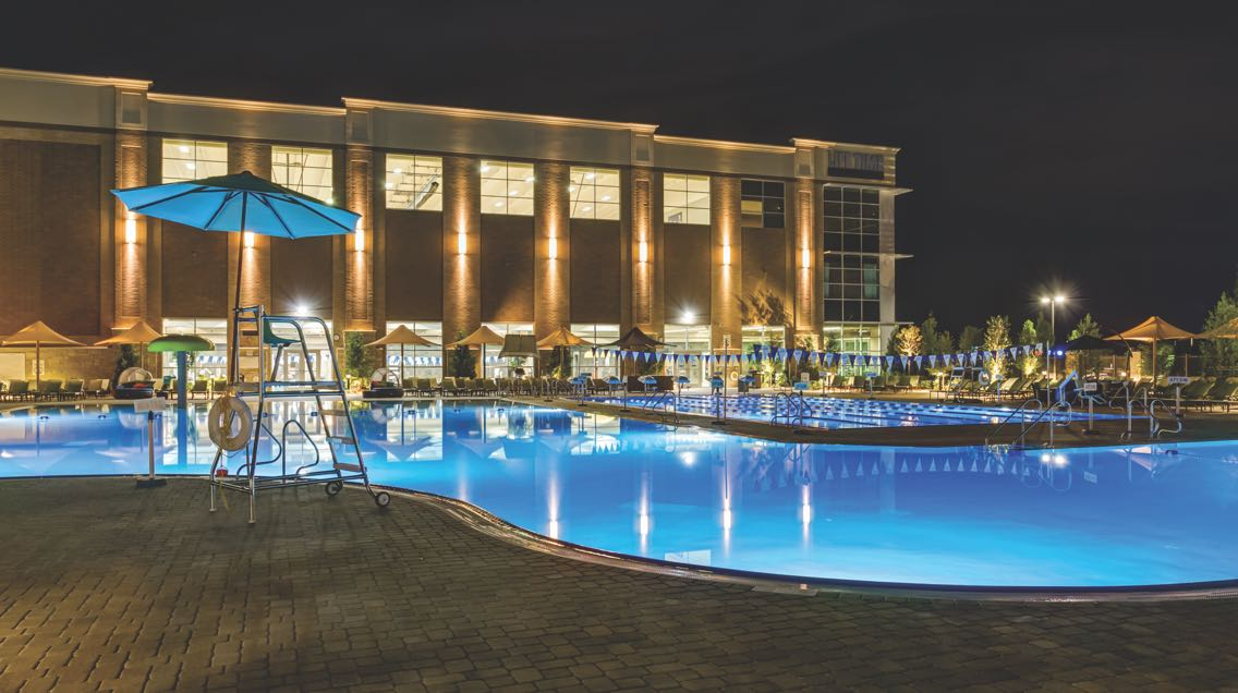 Life Time Athletic Westwood's outdoor pool lit up at night