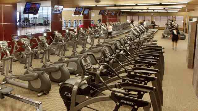 Rows of fitness equipment