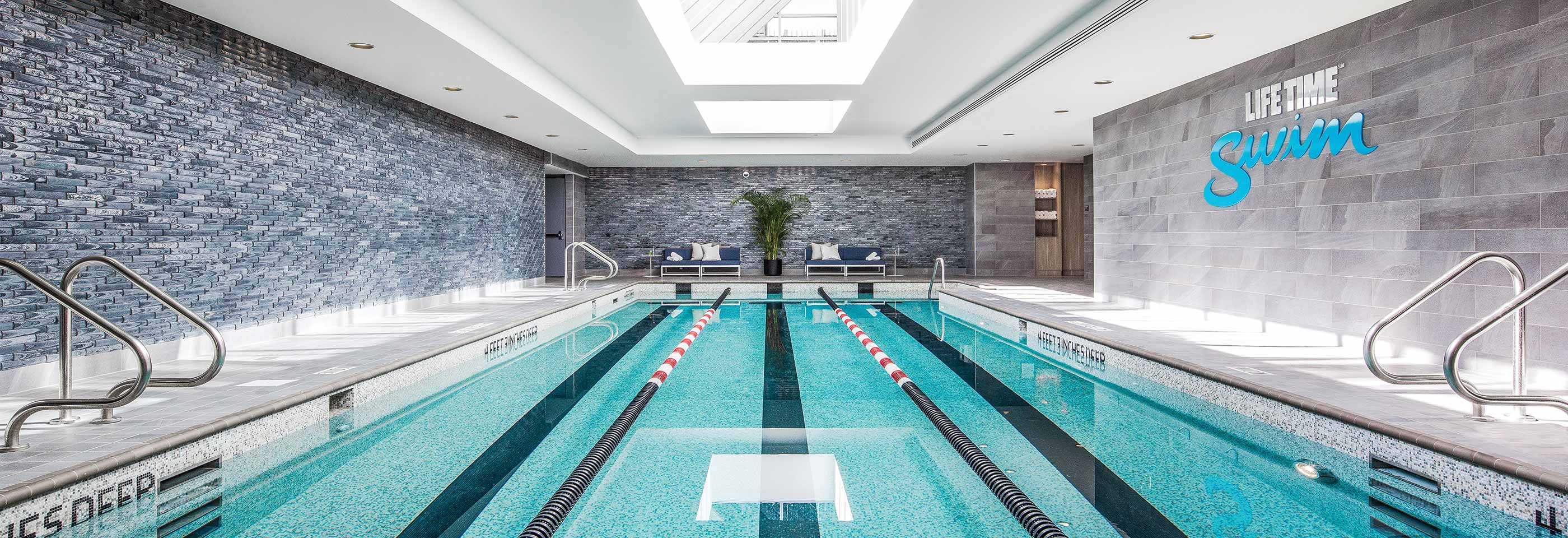 The indoor lap pool at Life Time Athletic Sky