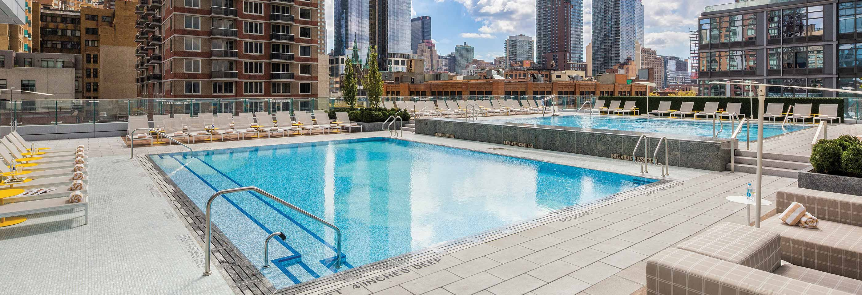 The outdoor rooftop pool at Life Time Athletic Sky