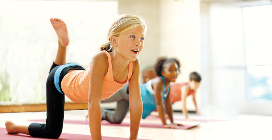 Children participating in a Kids Academy Yoga Class