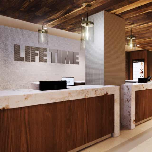 The welcome desk at Life Time {{club.clubTitle}}