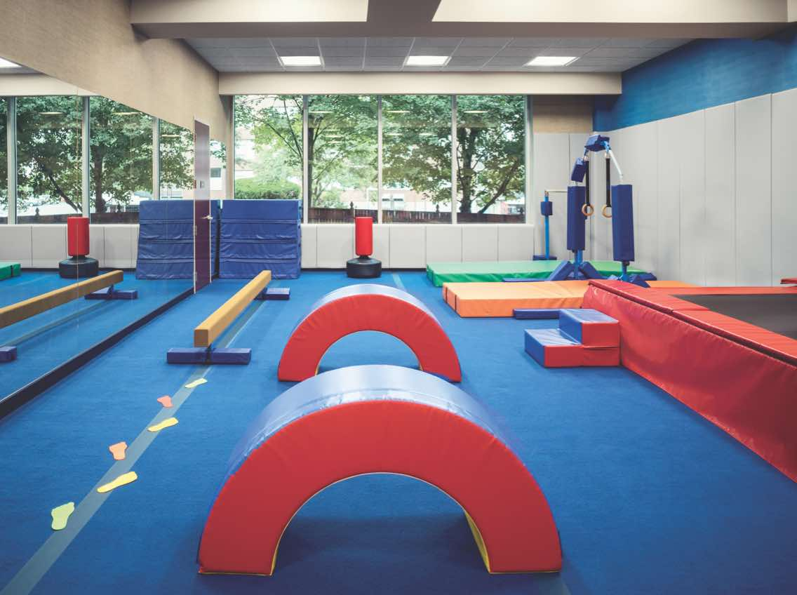 Kids tumbling area with mats at Life Time
