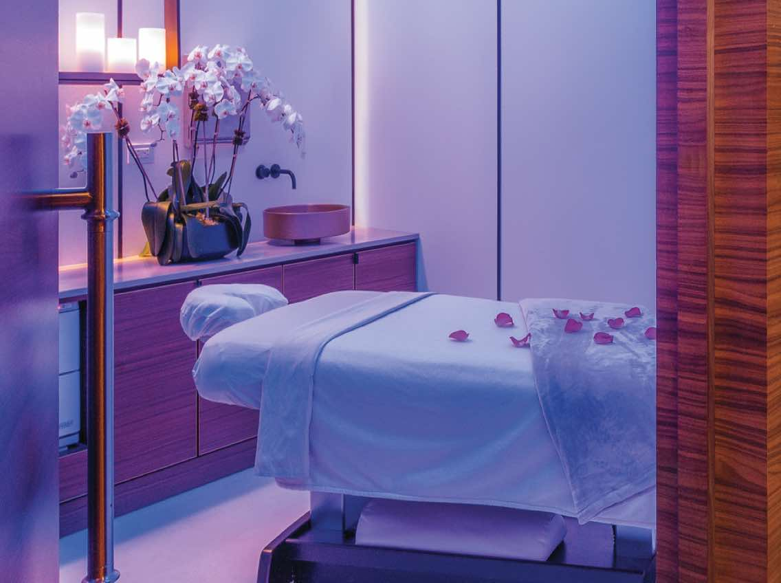 Peaceful massage room at LifeSpa with flowers and comfortable massage table