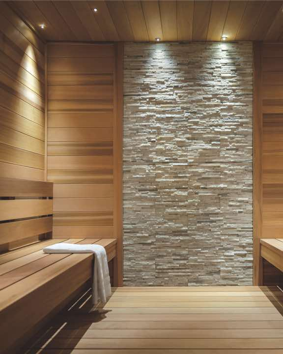 Peaceful sauna space with wooden benches and walls