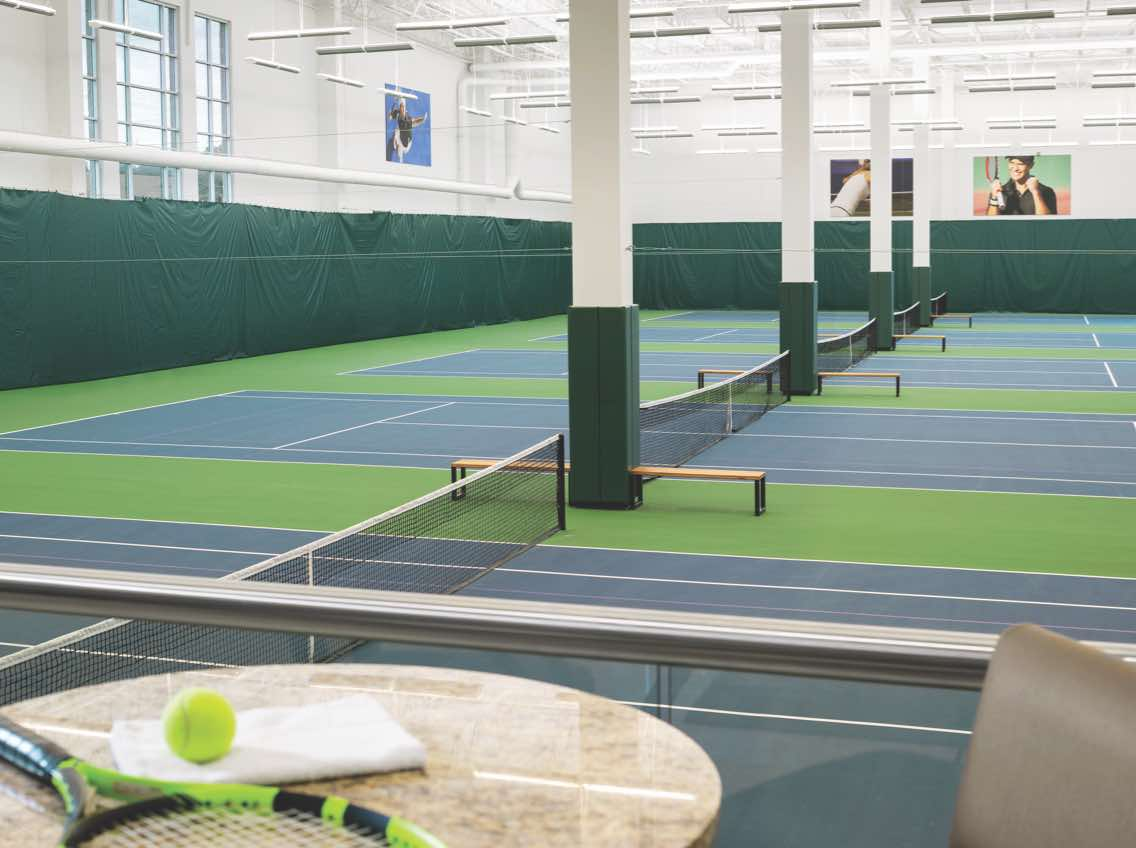 Expansive view of an indoor tennis facility at Life Time