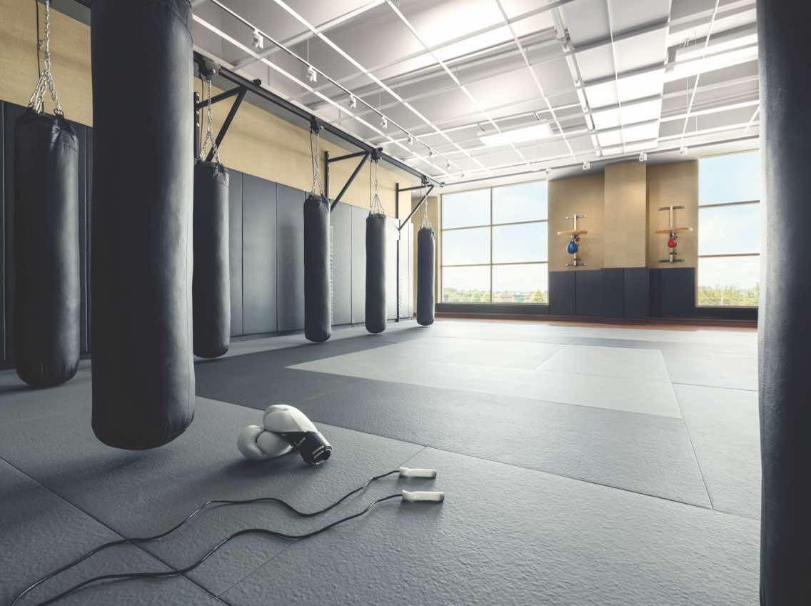 Kickboxing studio with row of hanging punching bags