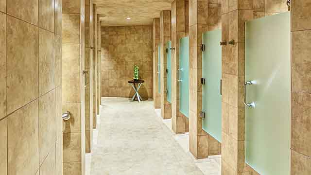 The tiled shower area inside a Life Time health club