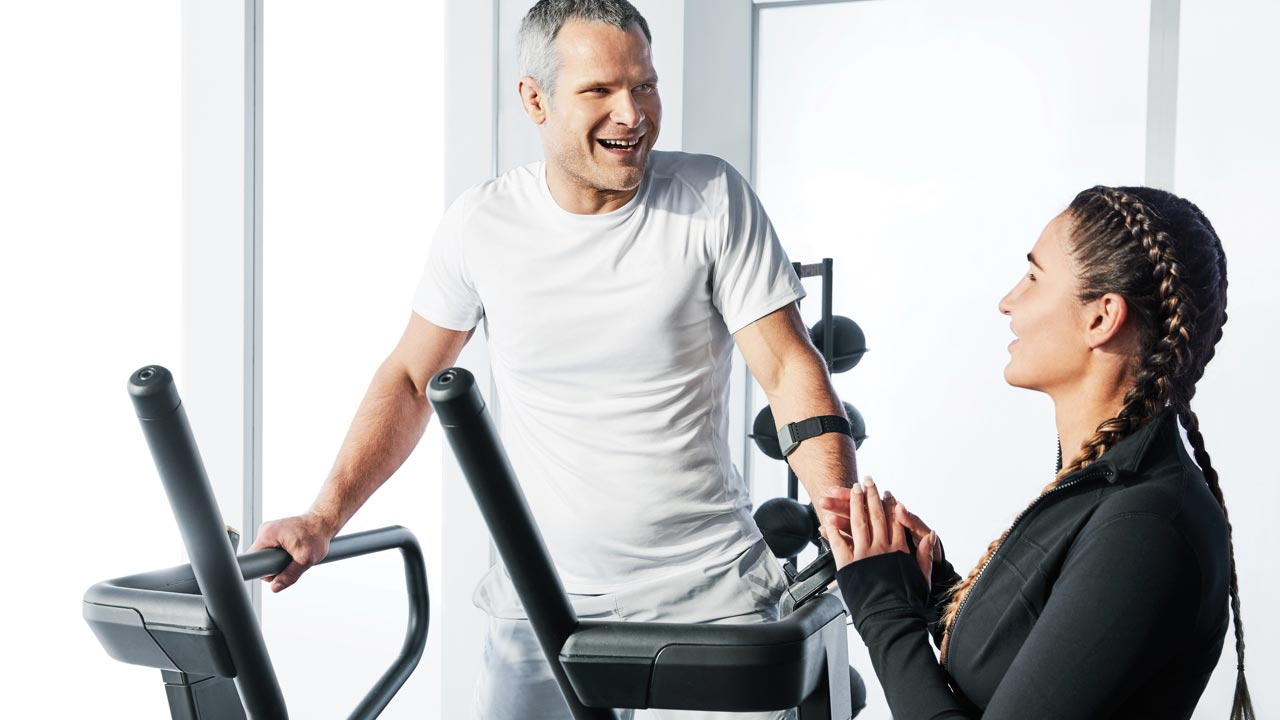 A man working with his personal trainer at Life Time