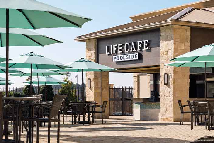 LifeCafe Poolside: Tables with umbrellas surround the poolside LifeCafe
