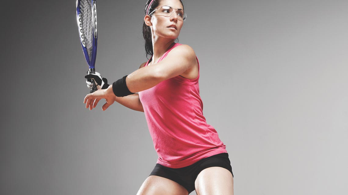 A woman set to swing with her racquetball racquet