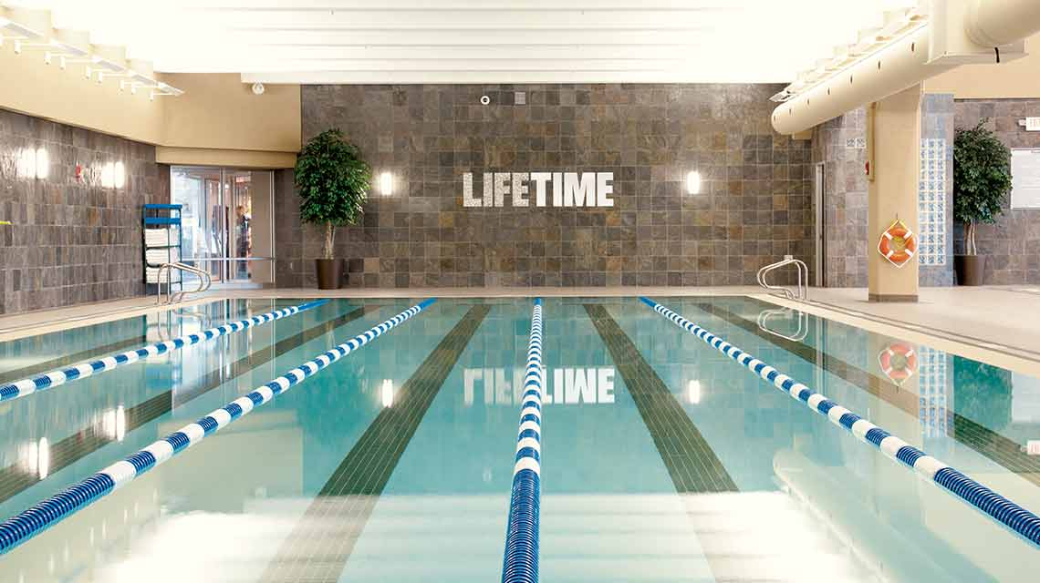 An indoor lap pool in a Life Time club